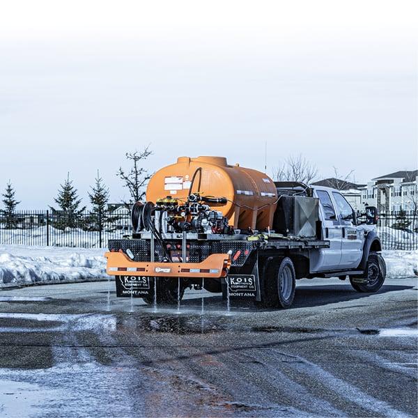 Liquid-Master-T-Series-De-Icing-a-Road-on-a-Truck